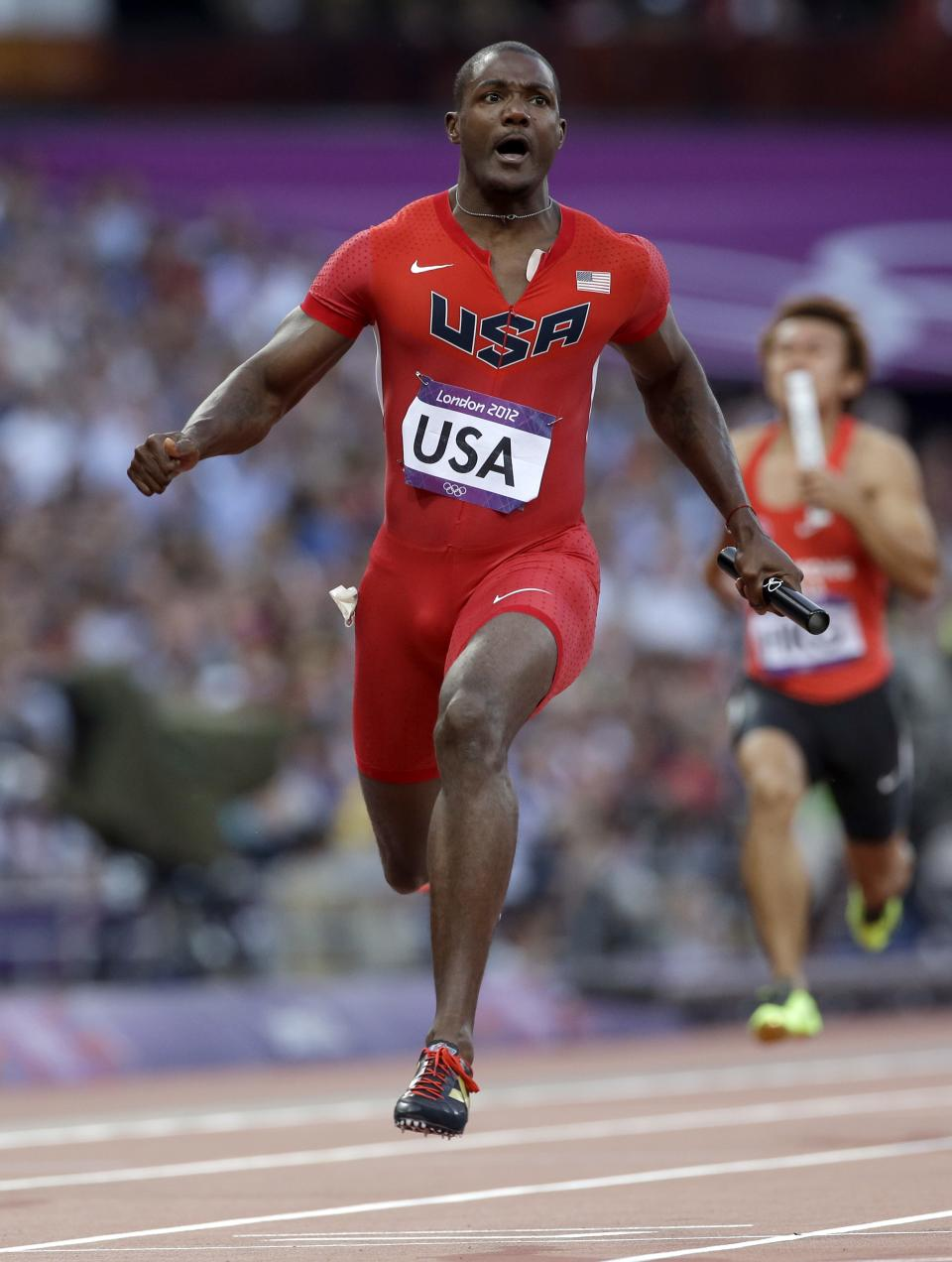 United States' Justin Gatlin competes in a men's 4 x100-meters relay heat during the athletics in the Olympic Stadium at the 2012 Summer Olympics, London, Friday, Aug. 10, 2012. (AP Photo/Anja Niedringhaus)