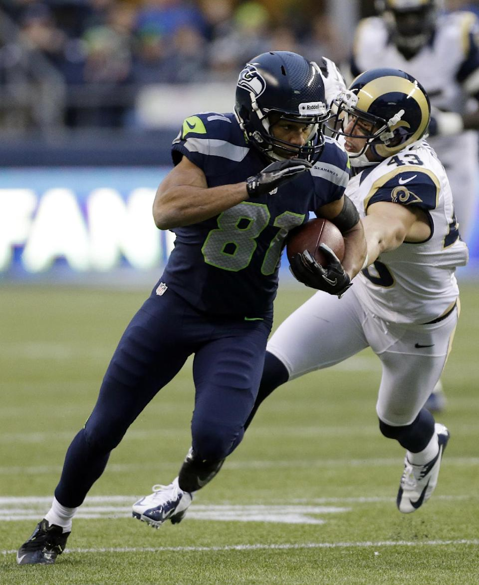 Seattle Seahawks wide receiver Golden Tate (81) runs the ball ahead of St. Louis Rams strong safety Craig Dahl, right, during the second half of an NFL football game, Sunday, Dec. 30, 2012, in Seattle. The Seahawks defeated the Rams, 20-13. (AP Photo/Elaine Thompson)