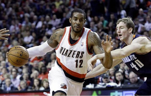 Portland Trail Blazers forward LaMarcus Aldridge, left, drives on Charlotte Bobcats center Cody Zeller during the second half of an NBA basketball game in Portland, Ore., Thursday, Jan. 2, 2014.  Aldr