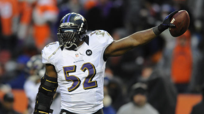 Baltimore Ravens inside linebacker Ray Lewis holds up the ball after recovering a fumble by Denver Broncos quarterback Peyton Manning (18) in the third quarter of an AFC divisional playoff NFL football game, Saturday, Jan. 12, 2013, in Denver. (AP Photo/Jack Dempsey)