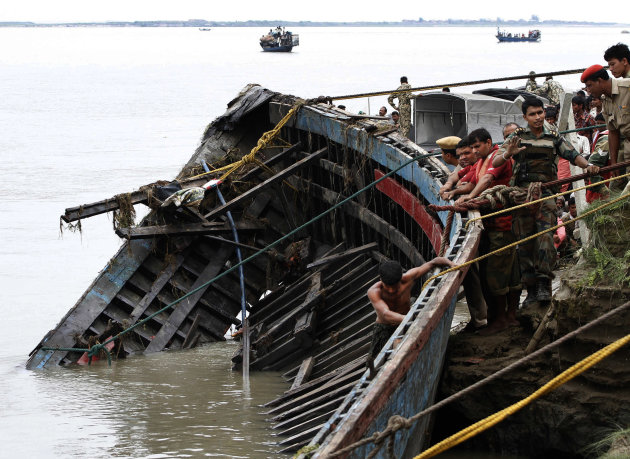 Rescuers pull out the wreckage of a ferry that capsized in the Brahmaputra River at Buraburi village, about 350 kilometers (215 miles) west of the state capital Gauhati, India, Tuesday, May 1, 2012. A