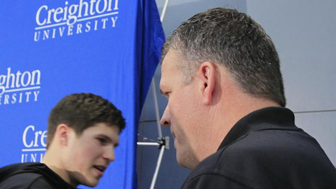 Creighton forward Doug McDermott, left, clasps hands with his father and Creighton men's basketball coach Greg McDermott, after an NCAA college basketball news conference in Omaha, Neb., Thursday, April 25, 2013. The All-America forward says he'll return to Creighton for his senior year instead of declaring for the NBA draft. (AP Photo/Nati Harnik)