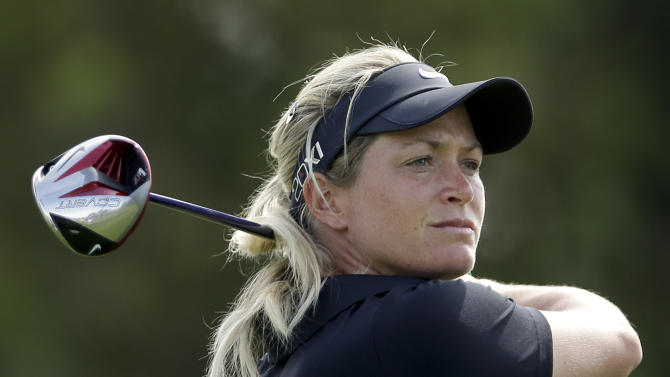 Suzann Pettersen, of Norway, watchers her tee shot on the third hole during the first round of the LPGA Kraft Nabisco Championship golf tournament in Rancho Mirage, Calif. Thursday, April 4, 2013. (AP Photo/Chris Carlson)