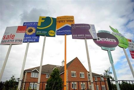 Residential property sales signs are seen on a street in west London July 12, 2008. REUTERS/Toby Melville