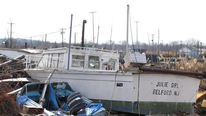 In a Dec. 12, 2012 photo, fishing boats lie smashed against one another from Superstorm Sandy at the Belford fishing port in Middletown N.J. The port sustained nearly $1 million in damages, some of which its owners hope to recoup through federal storm aid. (AP Photo/Wayne Parry)