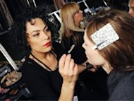 Fabiana Gomes, M.A.C.'s senior artist of Brazil, applies makeup on a model.
