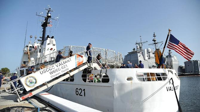 Crew members of the U.S. Coast Guard cutter Valiant bring their families onboard the cutter after returning to their homeport, Naval Station Mayport, Friday, July 3, 2015, in Jacksonville, Fla., following a 10-week deployment to the Florida Straits and Windward Passage in support of Operation Southeast Watch. (AP Photo/Florida Times-Union, Bruce Lipsky)