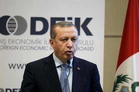Turkish President Tayyip Erdogan talks at a business forum during a visit in Lima