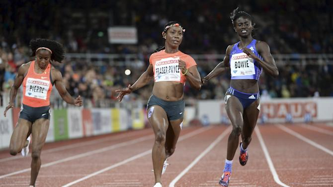 Shelly-Ann Fraser-Pryce of Jamaica wins the women's 100m race ahead of Tori Bowie of the U.S. and Natasha Morrison of Jamaica, at the IAAF Athletics Diamond League meeting at Stockholm Olympic Stadium