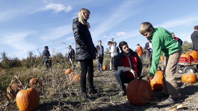 Republican vice presidential candidate, Rep. Paul Ryan, cneter, R-Wis., and his wife Janna help their son Charlie pick a pumpkin at the Apple Holler farm pumpkin patch, Sunday, Oct. 7, 2012 in Sturtevant, Wis.  (AP Photo/Mary Altaffer)