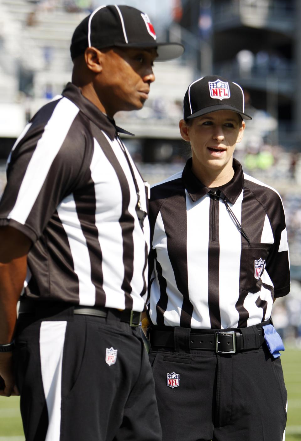 Official Shannon Eastin, right, talks with another official before an NFL football game between the Dallas Cowboys and Seattle Seahawks, Sunday, Sept. 16, 2012, in Seattle. (AP Photo/Kevin P. Casey)