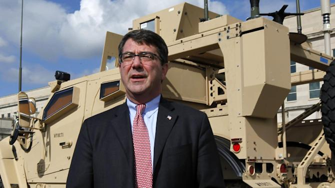 "FILE - This Nov. 2, 2009, file photo shows Deputy Defense Secretary Ashton Carter standing in front of a MRAP all terrain vehicle (M-ATV) at the Pentagon in Washington. The Afghan war effort eventually would be harmed by across-the-board budget cuts, even as the Obama administration intends to shield the military's combat mission from the reductions, Carter said Friday, Jan. 25, 2012. ""There will be second-order effects on the war,"" Carter said in an interview in his office with a small group of reporters. (AP Photo/Manuel Balce Ceneta, File)"