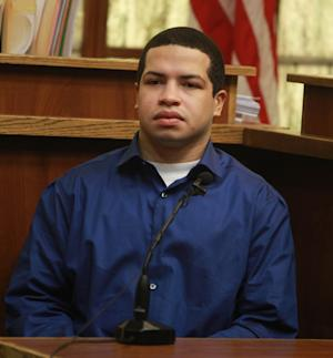 Eric Rivera, sits with his the defense team during his trial for the slaying of Sean Taylor Tuesday, Oct. 29, 2013, in MIami. Rivera blamed the shooting on another member of the group of five that drove from Fort Myers to Miami, supposedly to steal large amounts of cash they thought Taylor kept around. (AP Photo/The Miami Herald, Peter Andrew Bosch, Pool) NO SALES