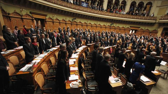 Members of the newly elected Swiss parliament attend the swearing-in ceremony at the beginning of the winter parliament session in Bern