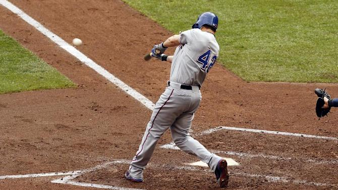 Texas Rangers' Michael Young hits a double against Minnesota Twins pitcher Liam Hendriks during the fourth inning of a baseball game on Sunday, April 15, 2012, in Minneapolis. The Rangers defeated the Twins 4-3. (AP Photo/Genevieve Ross)