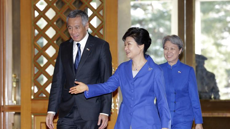 South Korean President Park greets Singapore's PM Lee and his wife upon their arrival for a meeting in Seoul