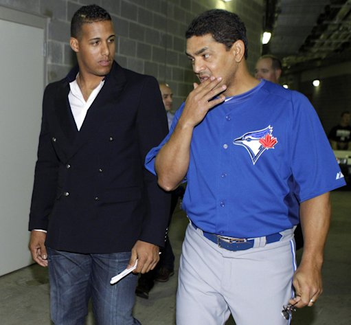 Toronto Blue Jays' Yunel Escobar, left, and coach Luis Rivera leave a news conference at Yankee Stadium in New York, Tuesday, Sept. 18, 2012. Escobar was suspended for three games Tuesday by the Blue Jays for wearing eye-black displaying a homophobic slur written in Spanish during last Saturday's game against the Boston Red Sox. (AP Photo/Kathy Willens)