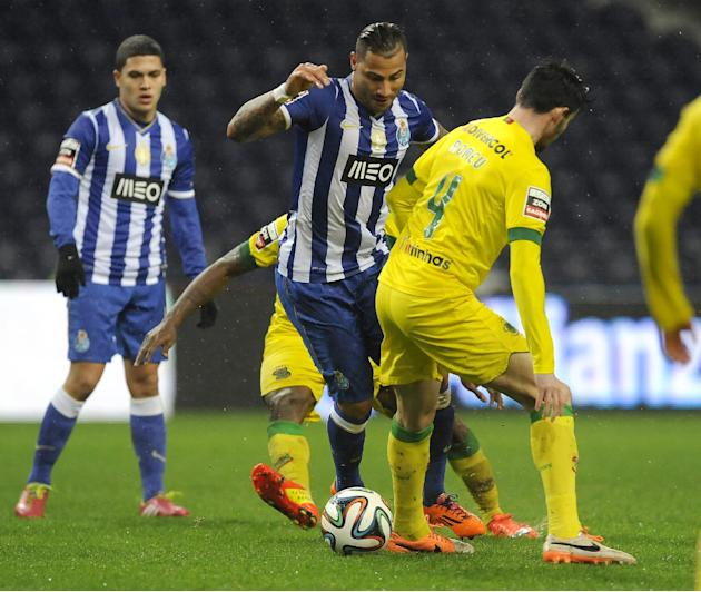FC Porto's Ricardo Quaresma, centre, drives the ball past Pacos Ferreira's Romeu Rocha, right, and Jean Seri, from Ivory Cost, with Juan Quintero from Colombia at left, in a Portuguese League