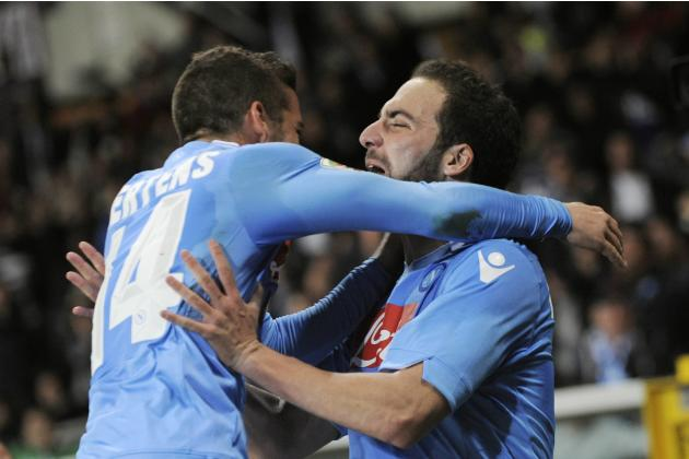 Napoli's Higuain celebrates with his team mate Mertens after scoring against Torino FC during their Italian Serie A soccer match in Turin