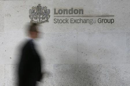 FTSE share index ends higher, miners help