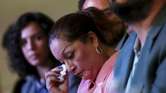 Clara Gomez Gonzalez cries in news conference to present a report about the Tlatlaya case, in Mexico City