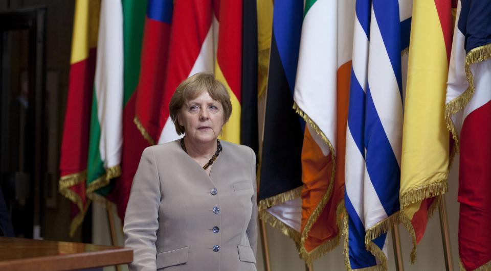 German Chancellor Angela Merkel leaves an EU Summit in Brussels on Friday, June 29, 2012. European leaders have agreed to use the continent's permanent bailout fund to recapitalize struggling banks, and agreed to the idea of a tighter union in the long term. (AP Photo/Virginia Mayo)