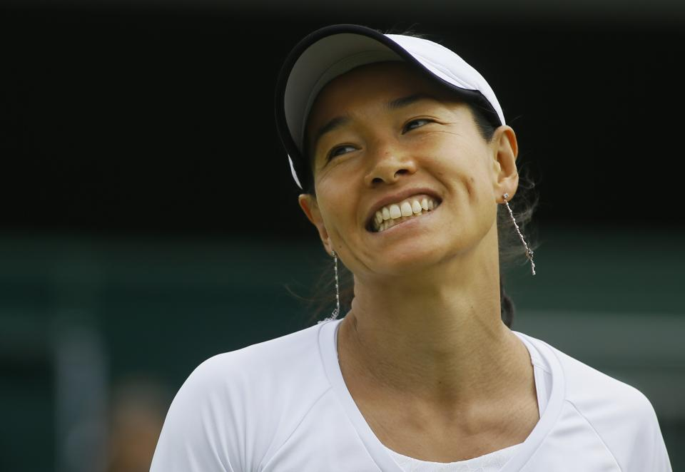 Kimiko Date-Krumm of Japan reacts as she plays Alexandra Cadantu of Romania in a Women's second round singles match at the All England Lawn Tennis Championships in Wimbledon, London, Thursday, June 27, 2013. (AP Photo/Kirsty Wigglesworth)