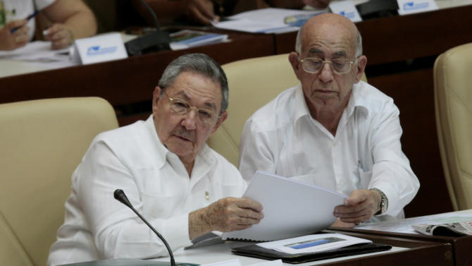Cuba's President Raul Castro, left, and Cuba's Vice President Jose Ramon Machado Ventura attend a session of the National Assembly in Havana, Cuba, Monday, Aug.1, 2011. Cuba's parliament was holding one of its business-packed twice-yearly sessions on Monday, a gathering that might enact some of the reforms that the government has promised in efforts to revive the stalled economy with a dose of private enterprise. (AP Photo/Ismael Francisco, Prensa Latina)