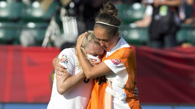 England's Josanne Potter, right, consoles Laura Bassett (6) after a 2-1 loss to Japan in a semifinal in the FIFA Women's World Cup soccer tournament, Wednesday, July 1, 2015, in Edmonton, Alberta, Canada. (Jason Franson/The Canadian Press via AP)