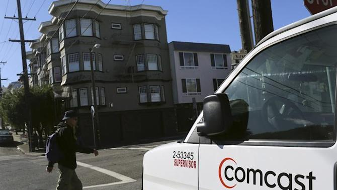 A Comcast sign is shown on the side of a vehicle in San Francisco