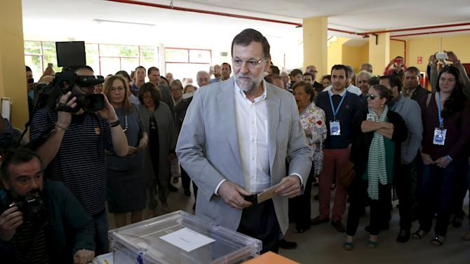 Spain's Prime Minister Rajoy arrives at a polling station during regional and municipal elections in Madrid