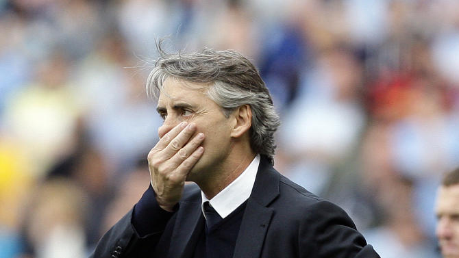 Manchester City's manager Roberto Mancini reacts from the touchline during their English Premier League soccer match against Queens Park Rangers at the Etihad Stadium, Manchester, England, Sunday May 13, 2012. (AP Photo/Jon Super)