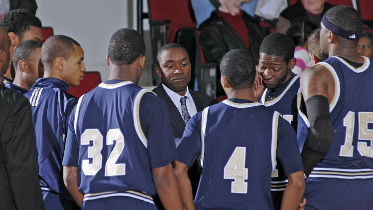 Florida International coach Isiah Thomas, center, talks to his players prior to an NCAA college basketball game against Troy in Troy, Ala., Thursday, Feb. 3, 2011. (AP Photo/The (Troy) Messenger, Thomas Graning) ** MANDATORY CREDIT **