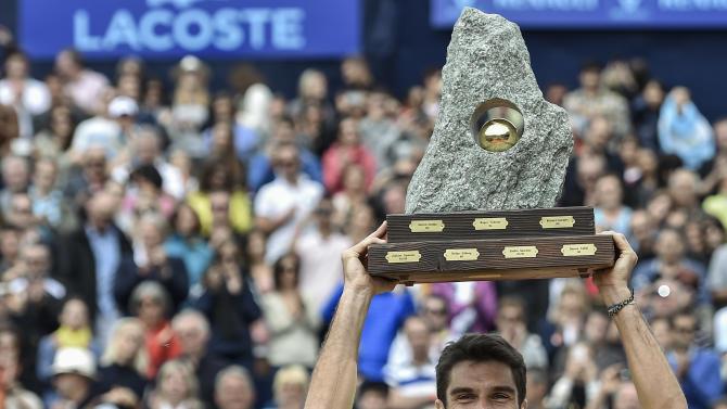 Gstaad champion Andujar wins opener in Kitzbuehel