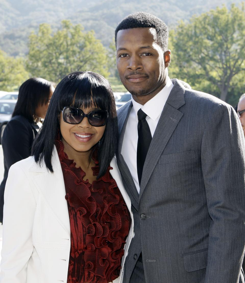 Flex Alexander and his wife Shanice Wilson arrive at a memorial service for singer Teena Marie at Forest Lawn-Hollywood Hills in Los Angeles Monday. Jan. 10, 2011.  Teena Marie, whose given name was Mary Christine Brockert, died Dec. 26, 2010, at age 54. (AP Photo/Reed Saxon)
