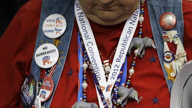 A delegate bows her head in a moment of prayer at the end of the second session of the Republican National Convention in Tampa, Fla., on Tuesday, Aug. 28, 2012. (AP Photo/Charlie Neibergall)
