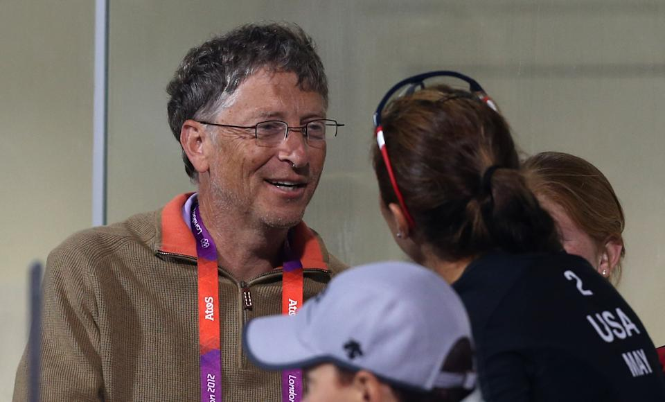 Misty MAy-Treadnor, right, of US talks to Bill Gates, left, at the Beach Volleyball venue at the 2012 Summer Olympics, Saturday, Aug. 4, 2012, in London. (AP Photo/Petr David Josek)