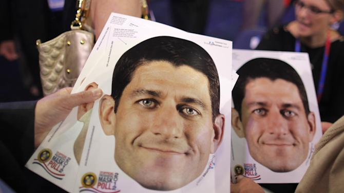 Wisconsin delegates hold masks of Republican vice presidential candidate, Rep. Paul Ryan, R-Wis., at the Republican National Convention in Tampa, Fla., on Wednesday, Aug. 29, 2012. (AP Photo/Charles Dharapak)