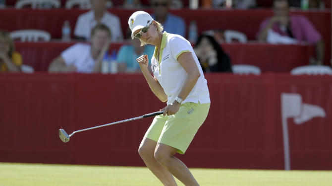 Karrie Webb, of Australia, pumps her fist as she anticipates a birdie putt falling into the cup on the 18th hole during the third round of the LPGA Kraft Nabisco Championship golf tournament in Rancho Mirage, Calif., Saturday, April 6, 2013. (AP Photo/Rodrigo Pena)