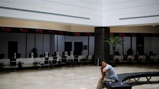 A man talks on the phone at the newly inaugurated Shanghai Free Trade Zone, in Pudong District, Shanghai