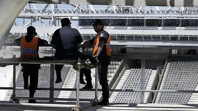 Argentine policemen chat on the grandstand of the Estadio Unico stadium (Reuters)