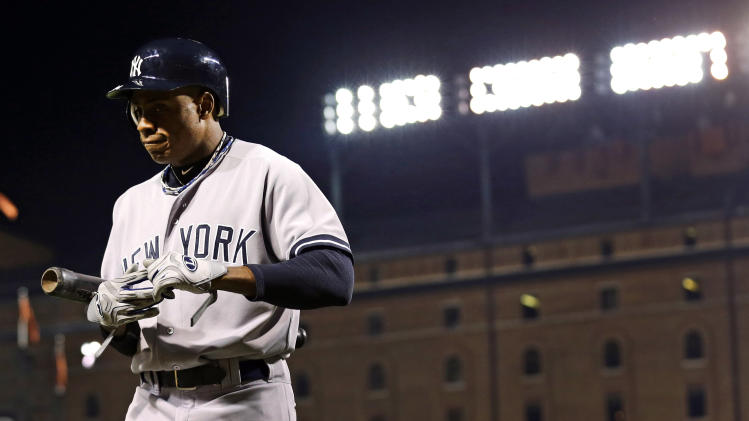 New York Yankees' Curtis Granderson walks off the field after striking out swinging in the eighth inning of Game 2 of the American League division baseball series against the Baltimore Orioles, Monday, Oct. 8, 2012, in Baltimore. Baltimore won 3-2. (AP Photo/Alex Brandon)