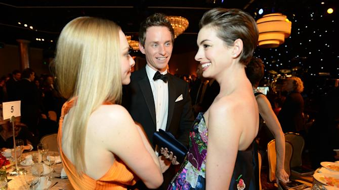 IMAGE DISTRIBUTED FOR THE PRODUCERS GUILD - From left, Amanda Seyfried, Eddie Redmayne and Anne Hathaway speak in the audience at the 24th Annual Producers Guild (PGA) Awards at the Beverly Hilton Hotel on Saturday Jan. 26, 2013, in Beverly Hills, Calif. (Photo by Jordan Strauss/Invision for Producers Guild/AP Images)