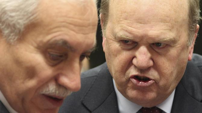 Irish Finance Minister Michael Noonan, right, talks with Cypriot Finance Minister and President of the EU rotating Council Vassos Chiarly, during the EU finance ministers meeting, at the European Council building in Brussels, Tuesday, Dec. 4, 2012. European Union finance ministers will seek to agree Tuesday to the principles of a eurozone banking supervisor, EU diplomats said. Earlier this year, the 27 member states pledged to reach the outlines of an agreement by the end of 2012, allowing the supervisor to come into force during the course of the following year. (AP Photo/Yves Logghe)