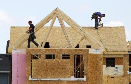 Construction workers build a new house in Calgary