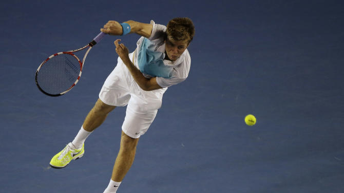 Ryan Harrison of the US serves to Serbia's Novak Djokovic during their second round match at the Australian Open tennis championship in Melbourne, Australia, Wednesday, Jan. 16, 2013. (AP Photo/Rob Griffith)