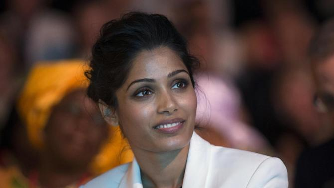 """Indian actress Freida Pinto, smiles, during the Girl Summit 2014, at the Walworth Academy, in London, Tuesday, July 22, 2014. """"Slumdog Millionaire"""" actress Freida Pinto has joined forces with girls' rights campaigners calling for an end to the practice of female genital mutilation. The actress, who is an ambassador for an international children's development organization, addressed a London summit Tuesday calling for more progress to abolish the practice and end child marriages. (AP Photo, PA, Oli Scarff) UNITED KINGDOM OUT"""