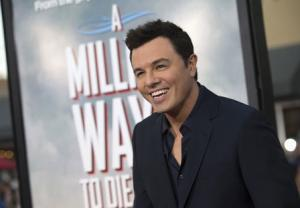 """Director and cast member MacFarlane poses at the premiere of """"A Million Ways to Die in the West"""" in Los Angeles"""