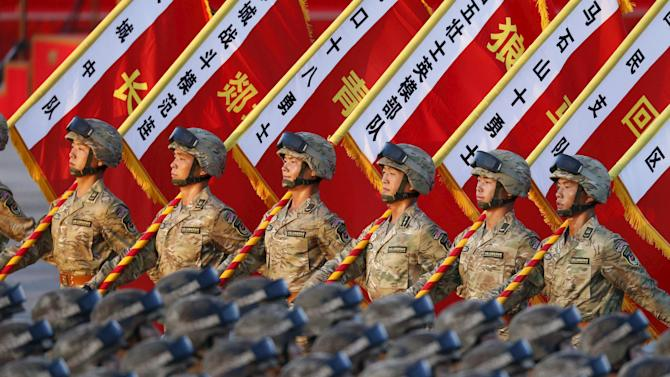 Soldiers of the People's Liberation Army (PLA) of China stand in formation as they gather ahead of a military parade to mark the 70th anniversary of the end of World War Two, in Beijing