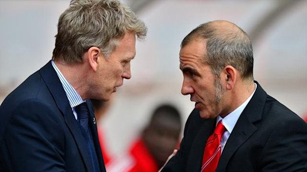 David Moyes', left, Everton suffered defeat as Sunderland boss Paolo Di Canio, right, claimed his second win